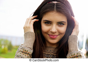 Closeup portrait of a young beautiful woman