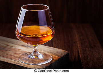 cognac on a wooden background