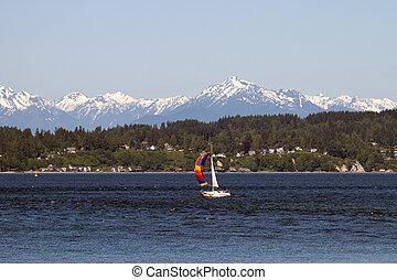 Colorful Sailboat on Puget Sound Olympic Peninsula Seattle Wasington