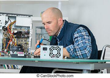 computer engineer working on broken console