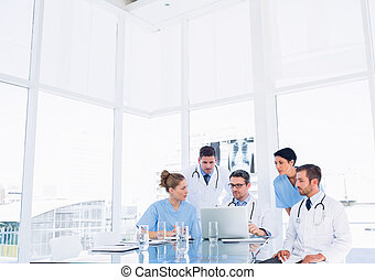 Concentrated medical team using laptop