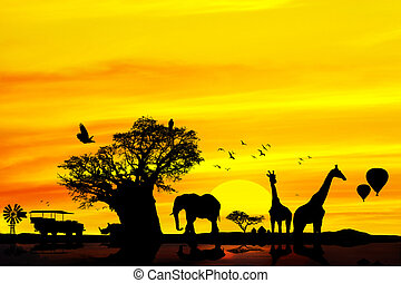 Conceptual african safari background with animal silhouettes at sunset.