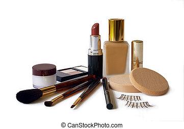 An assortment of women's make-up - foundation, powder, lipstick, eyeshadow, lip liner, cheek brush & fake eyelashes