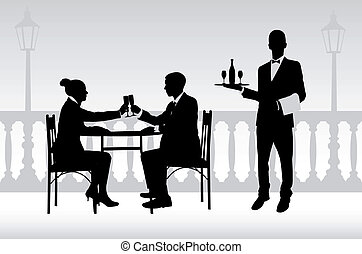 couple in the restaurant and waiter