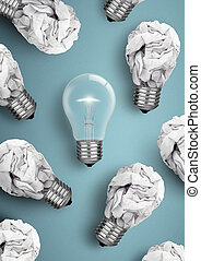 Creative idea concept, bulb with lot of crumpled paper bulbs