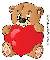 Cute teddy bear holding heart