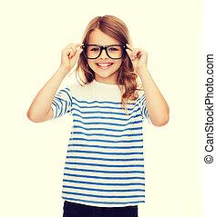 smiling cute little girl with black eyeglasses