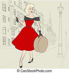 Elegant woman of 50s with hatbag on european city street