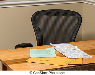 Empty desk at home with the paperwork for completing absentee voting ballot in Presidential election
