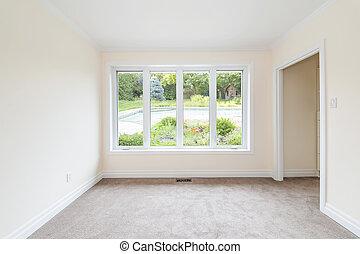 Empty room overlooking backyard