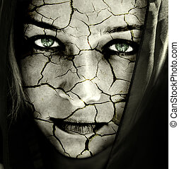 Global warming concept: face of woman with cracked skin