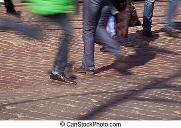 feet of pedestrians in a crosswalk