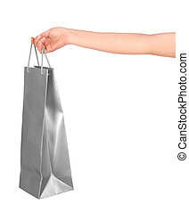Female hand holding paper bag isolated on white background