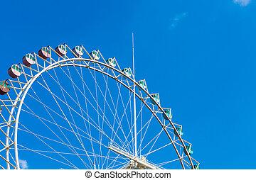 Ferris Wheel Over Blue Sky