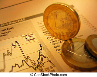 Euro coins and financial chart