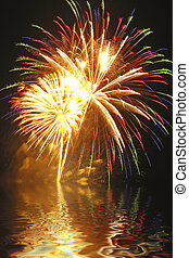 A beautiful fireworks display is captured in Connecticut with billowing smoke and water reflections.