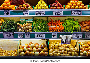 Photo of fresh organic fruit and vegetables on a farmers market stall.
