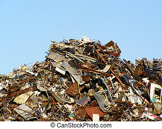 Hill of garbage on a sunny summer day