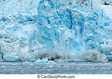 Ice falling from glacier in Alaska illustrating climate change