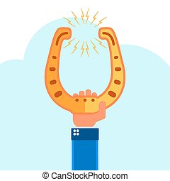 Golden horseshoe in hand