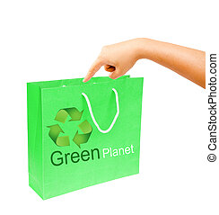 hand and blank green paper bag isolated on white background.