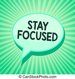 Handwriting text Stay Focused. Concept meaning Be attentive Concentrate Prioritize the task Avoid distractions Green speech bubble message reminder rays shadow important intention saying.