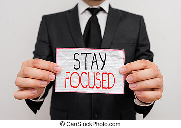 Handwriting text Stay Focused. Concept meaning Be attentive Concentrate Prioritize the task Avoid distractions.
