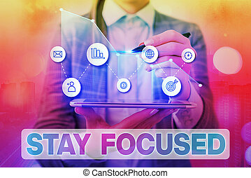 Handwriting text writing Stay Focused. Concept meaning Be attentive Concentrate Prioritize the task Avoid distractions Arrow symbol going upward denoting points showing significant achievement.