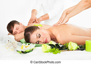 Happy Couple Getting Spa Treatment