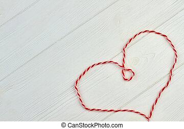 Heart shape of red wool.