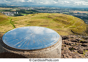 Huge compass on the top of Artur's Seat mountain