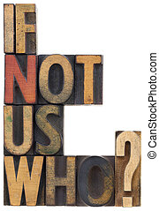 if not us, who - question or call for action, vintage wood lettepress type blocks, stained by ink, isolated on white