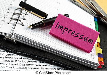 Impressum note on agenda and pen