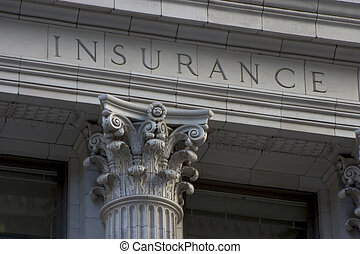 "Neoclassical architechture sports a column with the word ""INSURANCE"" above it. Neoclassical architechture sports a column with the word ""INSURANCE"" above it."
