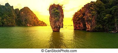 James Bond island sunset panoramic photography. Famous travel destination, Khao Phing Kan, Ko Tapu, Phang Nga Bay, Andaman Sea, Thailand. Exotic tropical nature landscape background