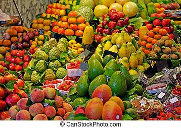 La Boqueria, fruits. World famous Barcelona market, Spain. Selective focus.