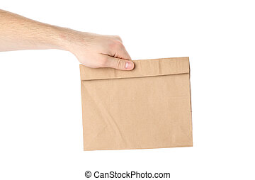 Male hand holds paper bag, isolated on white background