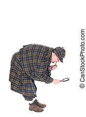 Male police officer dressed up as Sherlock Holmes investigating crime scene with magnifying glass.