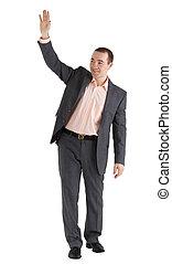 man waves his hand
