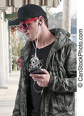 Man with tangled headphones