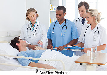 Medical team around the bed of a patient