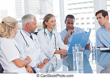 Medical team looking at a file