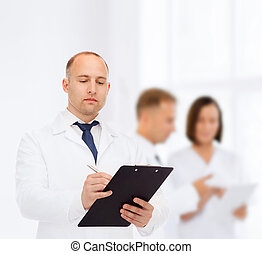 serious male doctor with clipboard