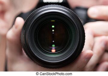 Human home photo - adult men holding lens camera