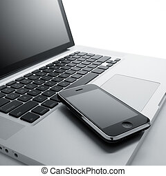 laptop computer and mobile phone against white background