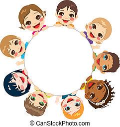 Multi-ethnic group of children holding a white round billboard
