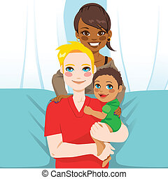 Happy multi ethnic family of white husband and black wife with their mixed race child