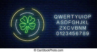 Neon glowing clover leaf sign in circle frames with alphabet. Green shamrock as Irish national holiday symbol.