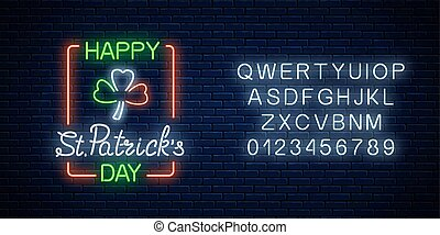 Neon glowing clover leaf sign in ireland flag colors with alphabet . Green shamrock as Ireland national holiday symbol