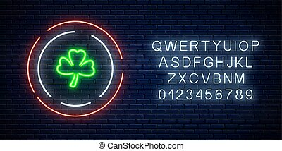 Neon glowing clover leaf sign with alphabet. Green shamrock as Irish national holiday symbol